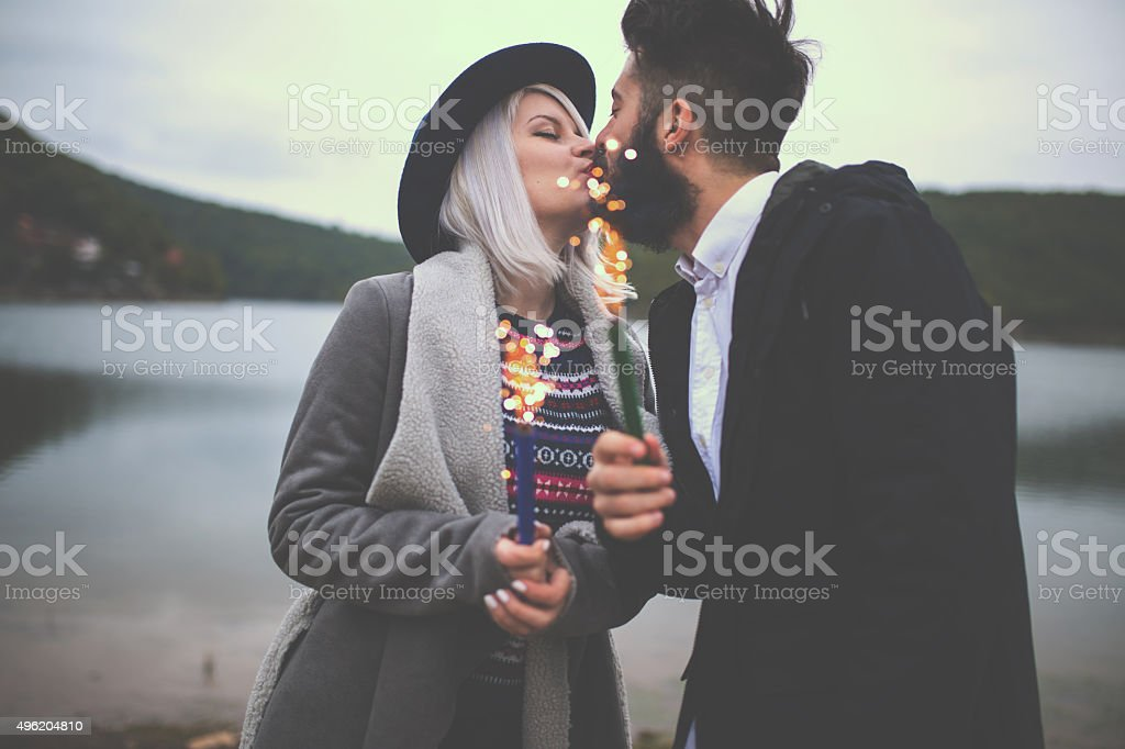 Young couple in love celebrating life stock photo