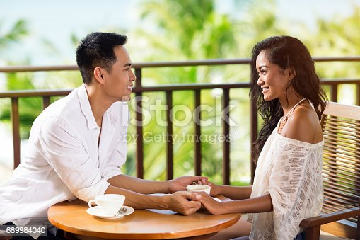 1065243116 istock photo Young couple in love drinking coffee 689984040