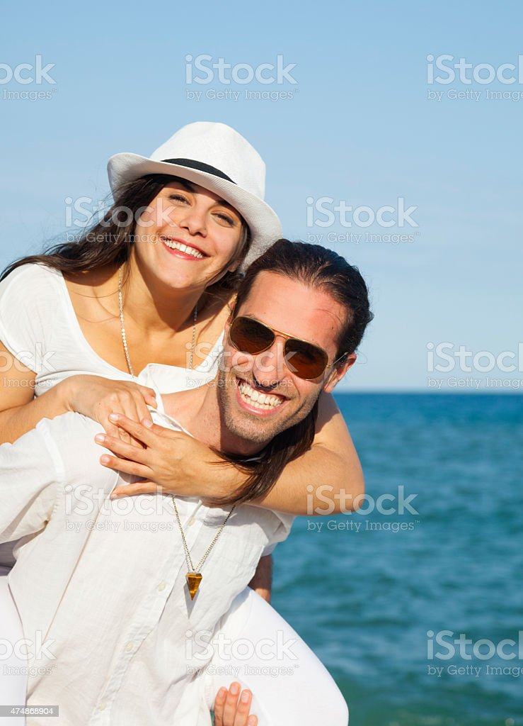 Young couple in love enjoying holidays stock photo
