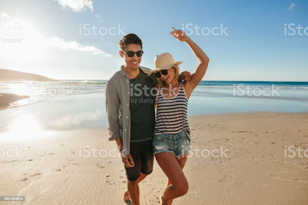 Young couple in love enjoying on the beach royalty-free stock photo