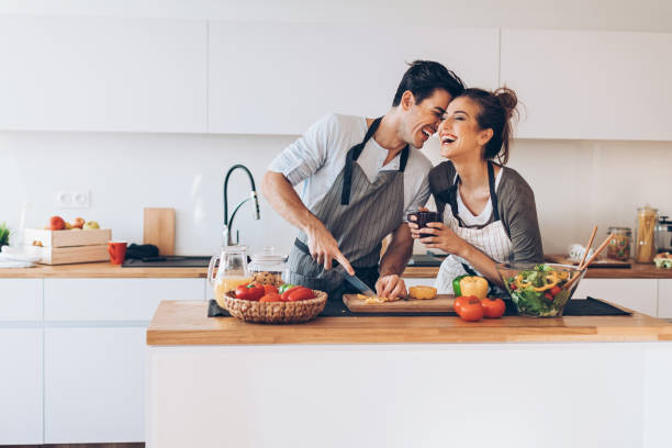 Young couple in love in the kitchen stock photo