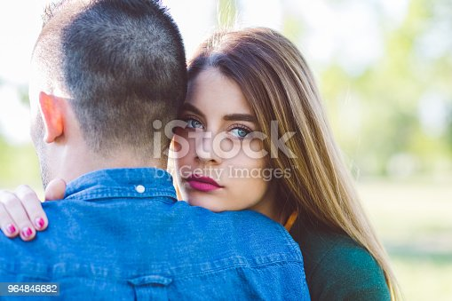 Young woman comforting unhappy friend