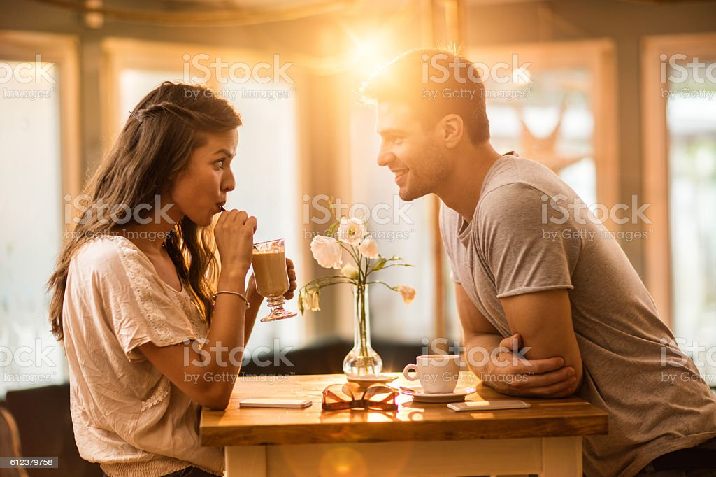 Young couple in love spending time together in a cafe. stock photo