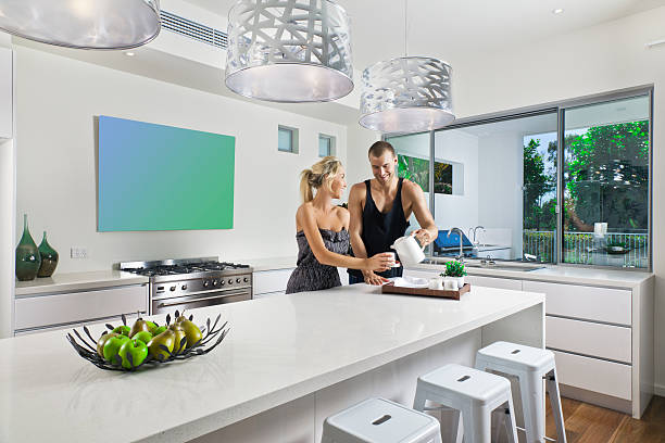 Young couple in modern kitchen stock photo