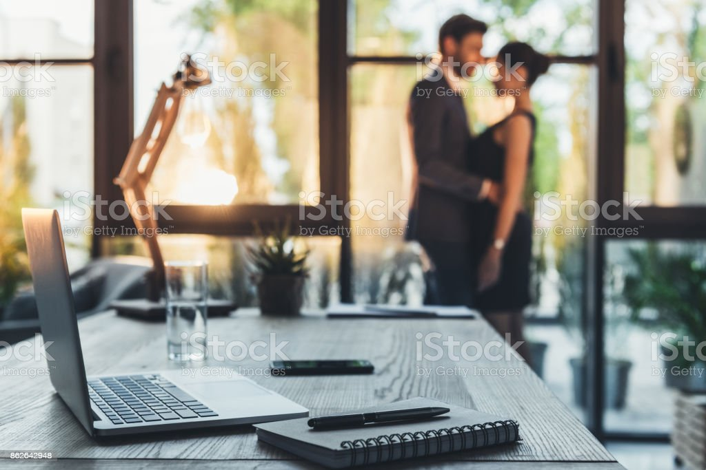 young couple in office stock photo