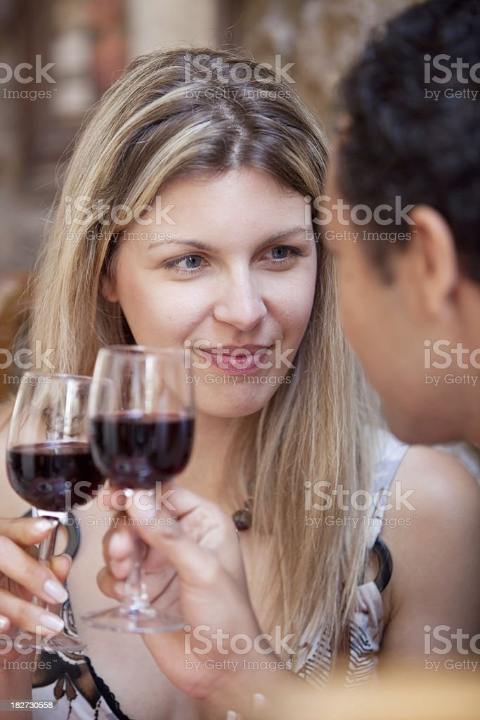 Young couple in restaurant drinking wine. stock photo