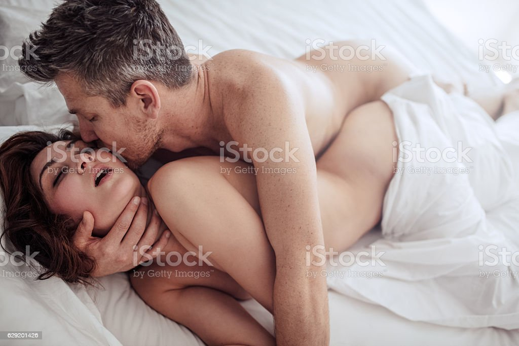 Young couple in sexual intercourse stock photo