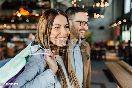 istock Young couple in shopping 1128055972