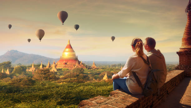 Young couple in summer vacation travels around Asia. stock photo