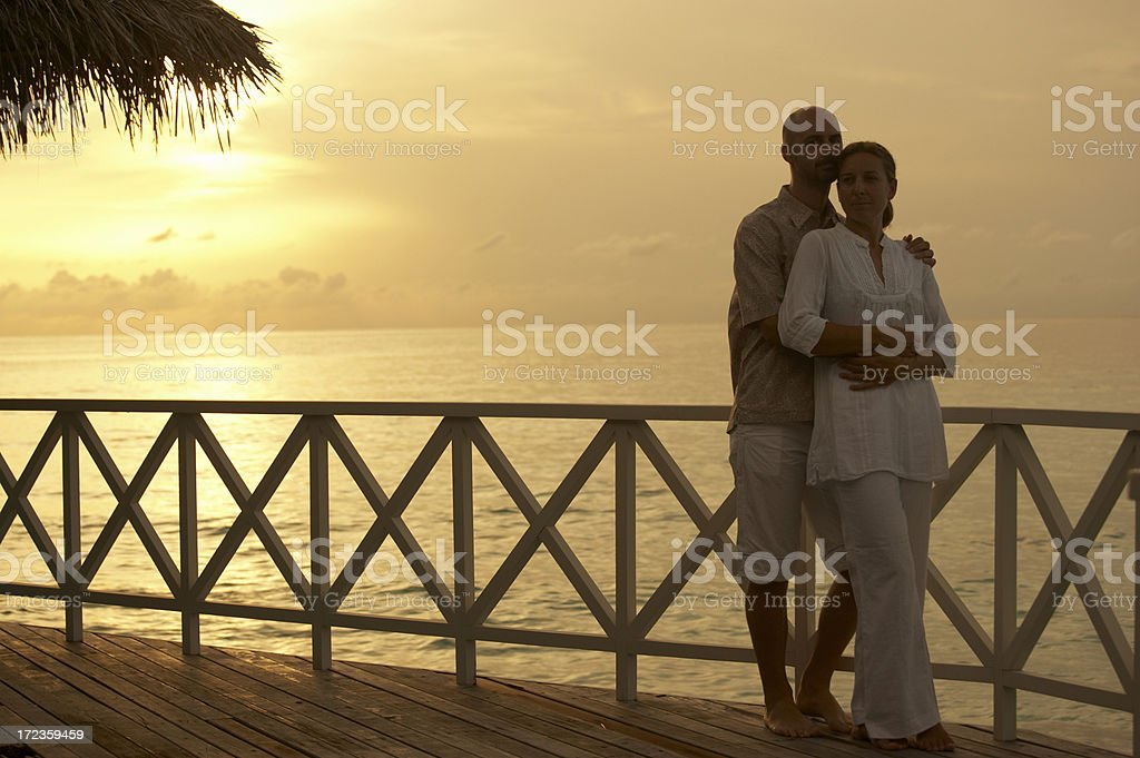 young couple in sunset royalty-free stock photo
