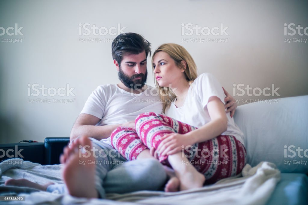 Young couple in the bed in the morning stock photo
