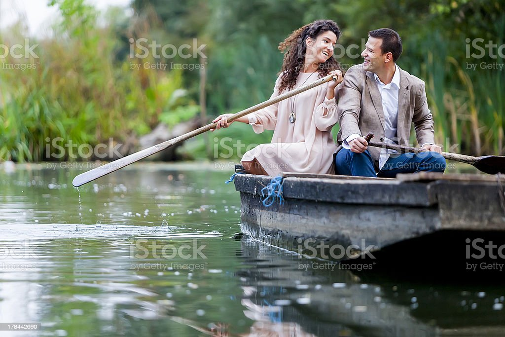 Young couple in the boat royalty-free stock photo