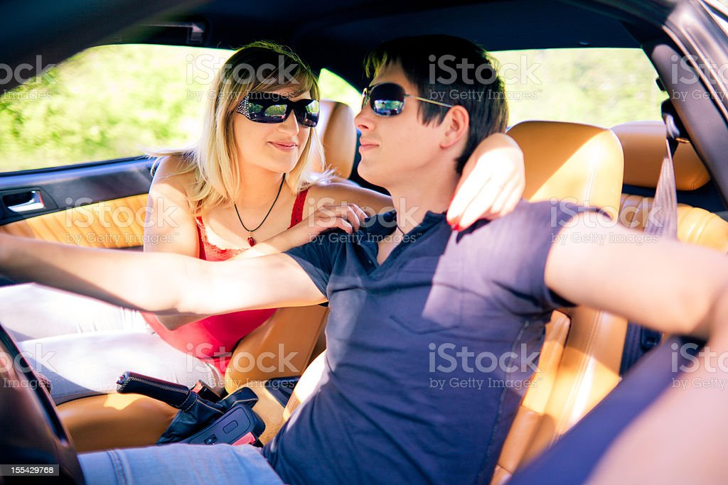 Young couple in the car stock photo
