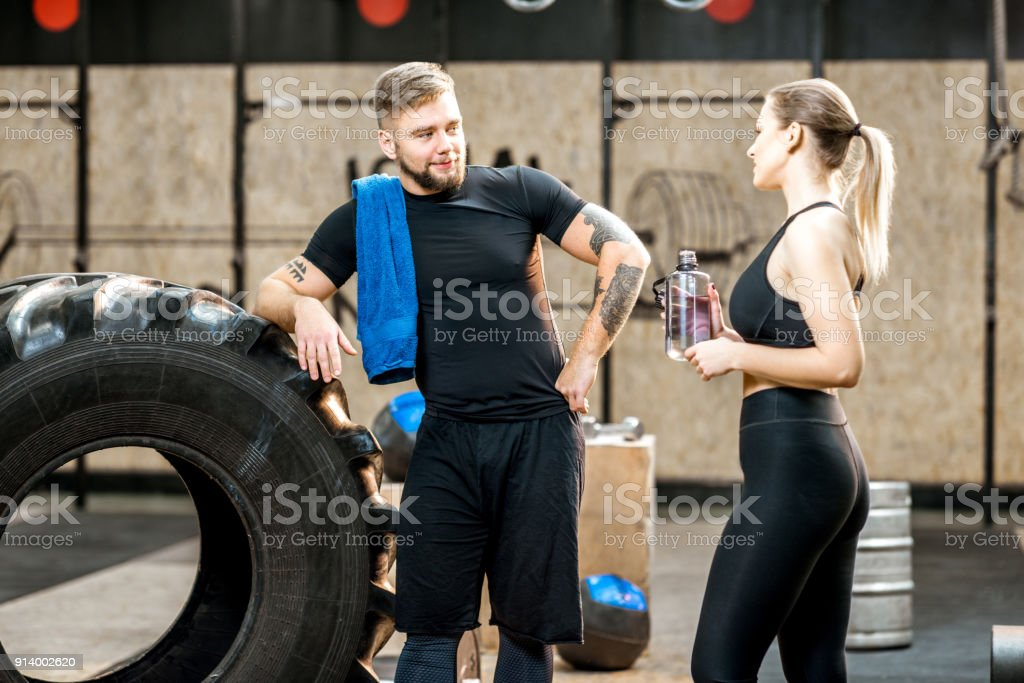 Young couple in the gym during the break stock photo