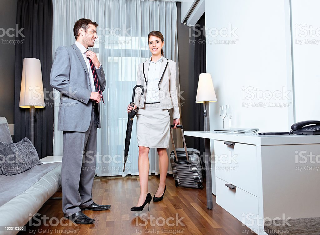 Young couple in the hotel room royalty-free stock photo