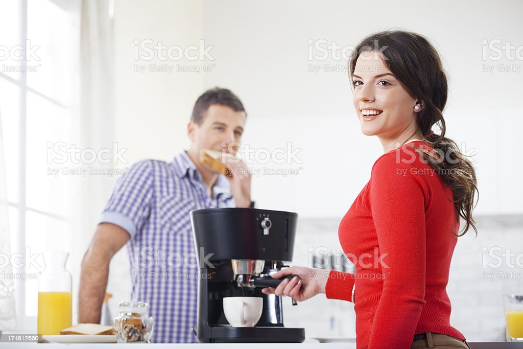 Young Couple In The Kitchen During Breakfast royalty-free stock photo