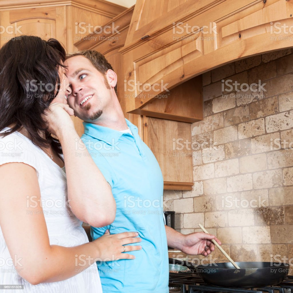 Young Couple in the Kitchen royalty-free stock photo