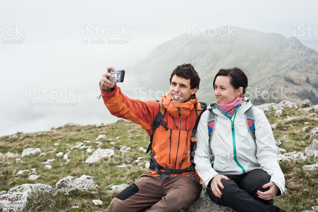 Young couple in the mountains. stock photo