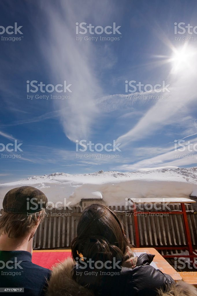 Young Couple in the Sun and Snow royalty-free stock photo