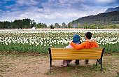 Young couple sitting relaxing  in tulip garden , Kashmir - India