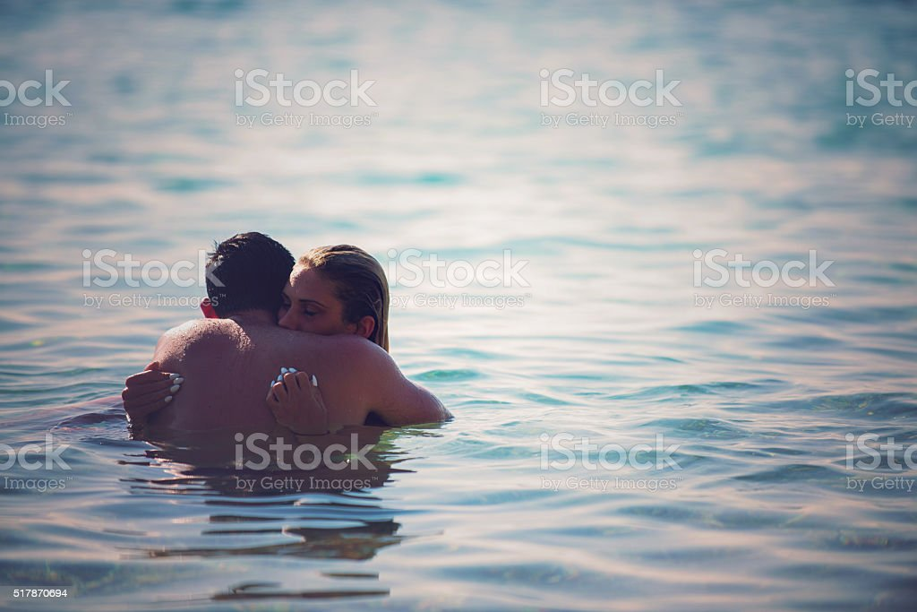 Young couple in water stock photo