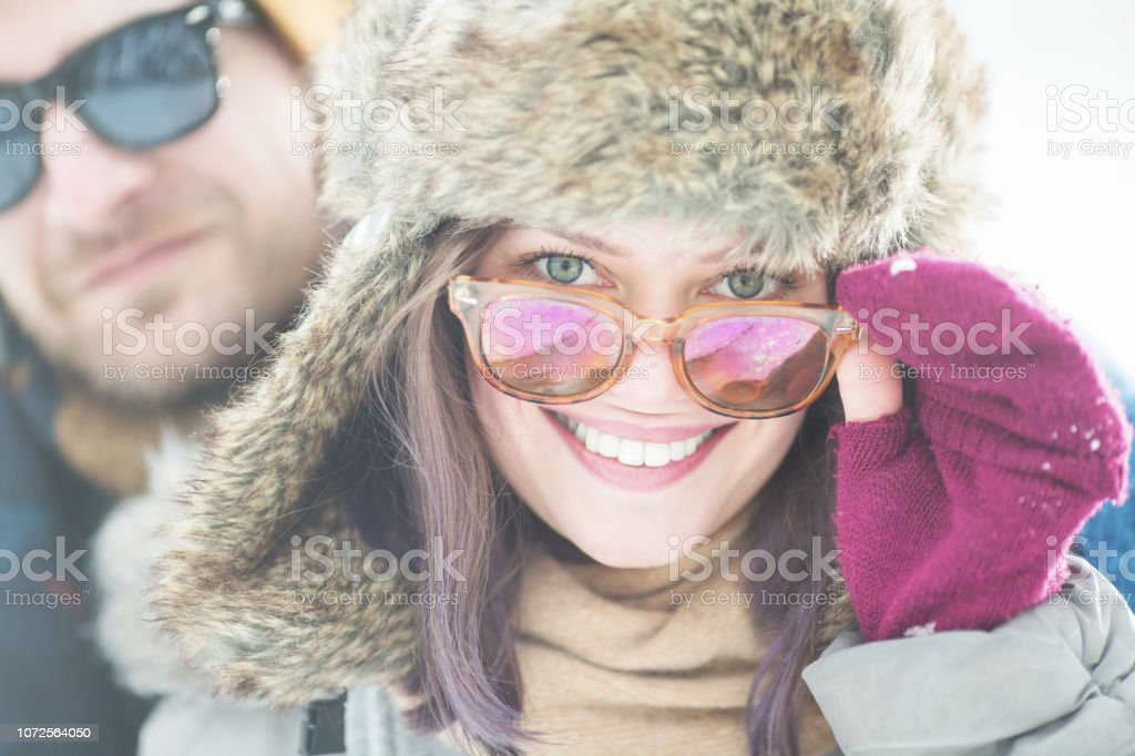 Young couple in winter outdoors stock photo