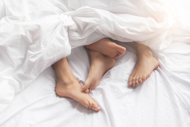 Young couple intimate relationship on bed passion stock photo