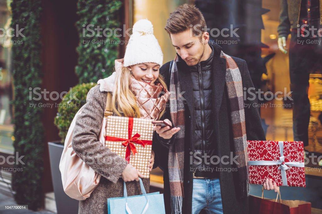 Young couple is buying Christmas presents