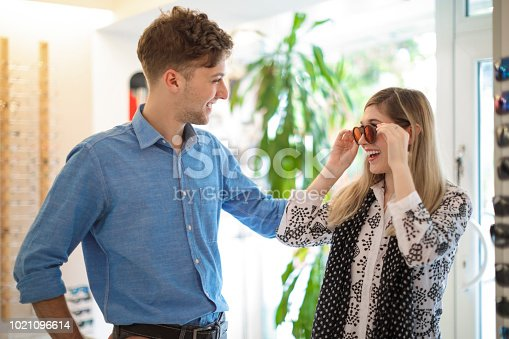 Young couple is buying sunglasses
