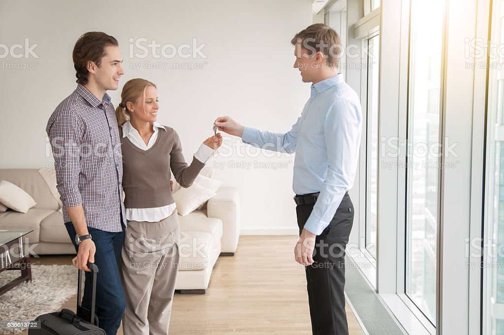 Young couple is given a key royalty-free stock photo