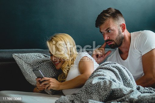 680684660 istock photo Young couple is having relationship problems 1176613365
