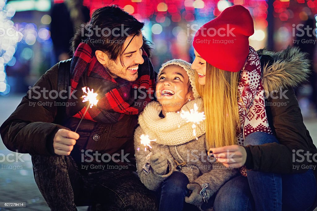 Young couple is hugging their daughter at Xmas stok fotoğrafı