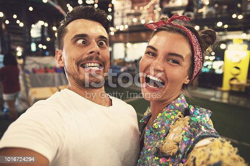 istock Young couple is making funny faces at evening street 1016724294