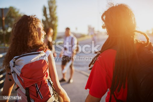 503545320istockphoto Young couple is meeting their friends for a holiday trip on a summer break. 1032716734