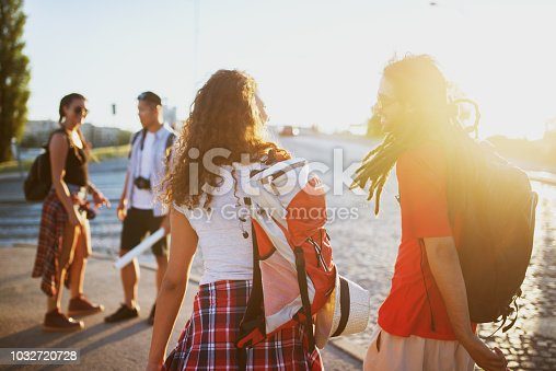 503545320istockphoto Young couple is meeting their friends for a holiday trip on a summer break. 1032720728