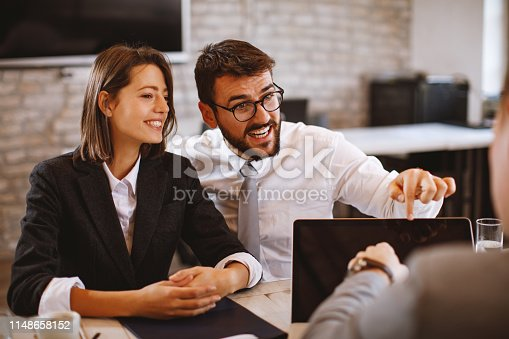 963814372istockphoto Young couple is negotiating with a bank loan manager 1148658152