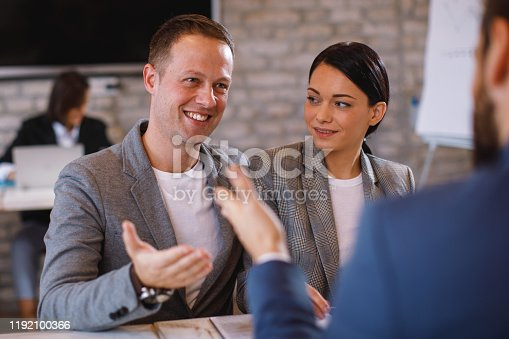963814372istockphoto Young couple is negotiating with a bank loan manager 1192100366