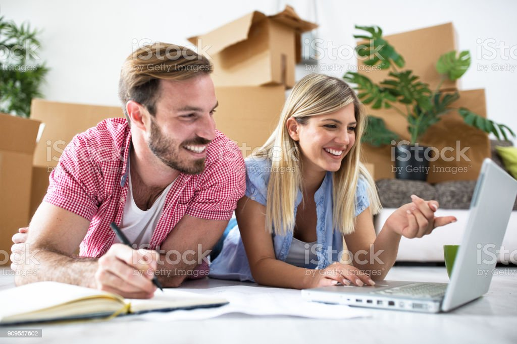Young couple is planning to equip a new home stock photo
