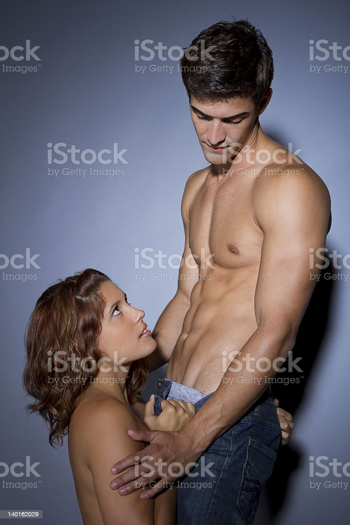 young couple is together, women seduces man stock photo
