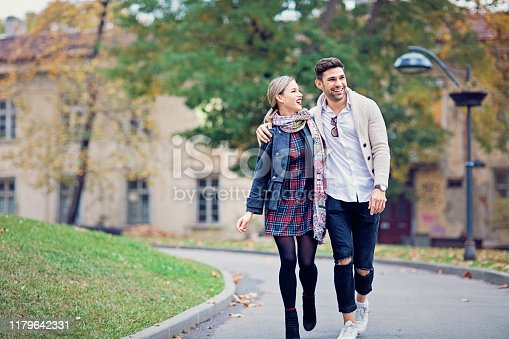 Young couple is walking in the autumn city