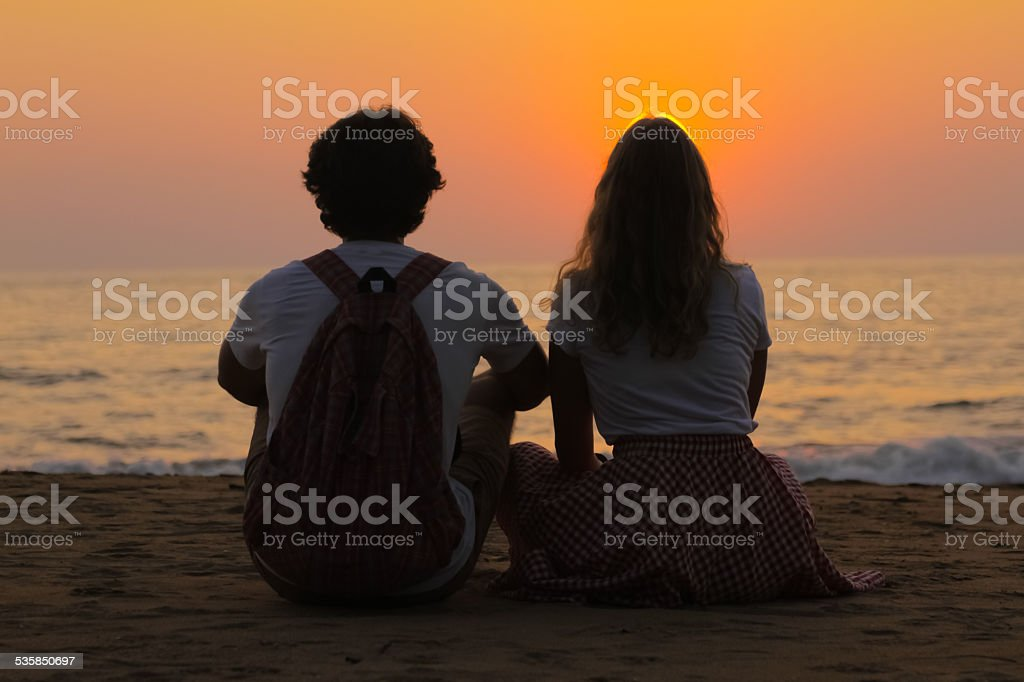 Young Couple is Watching Sunset stock photo