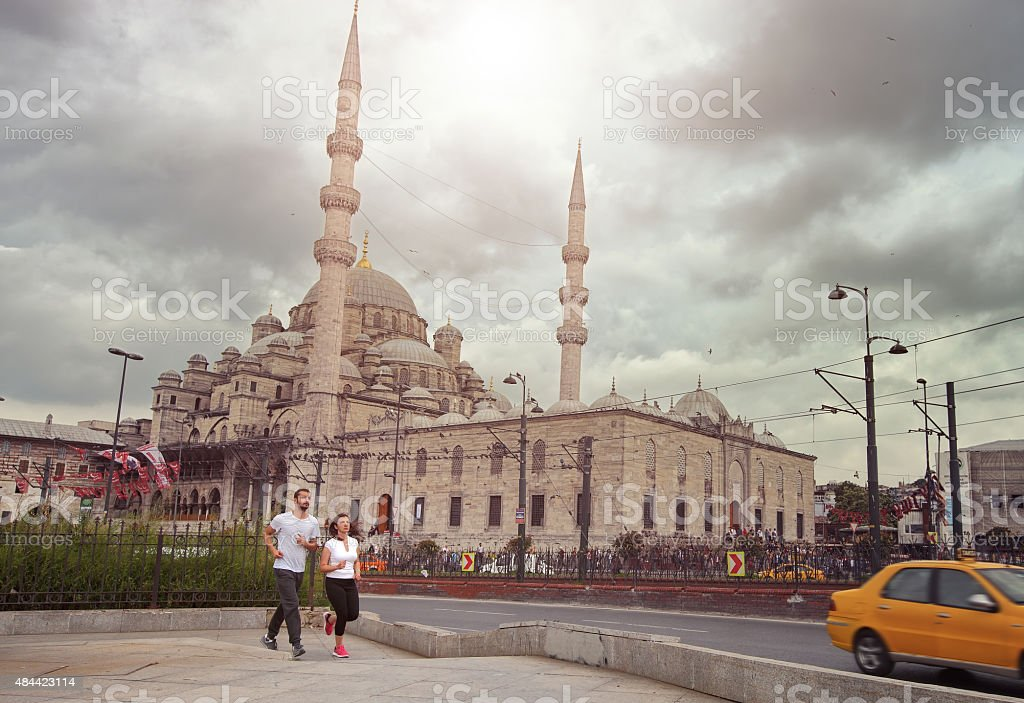 Young couple jogging in Istanbul stock photo