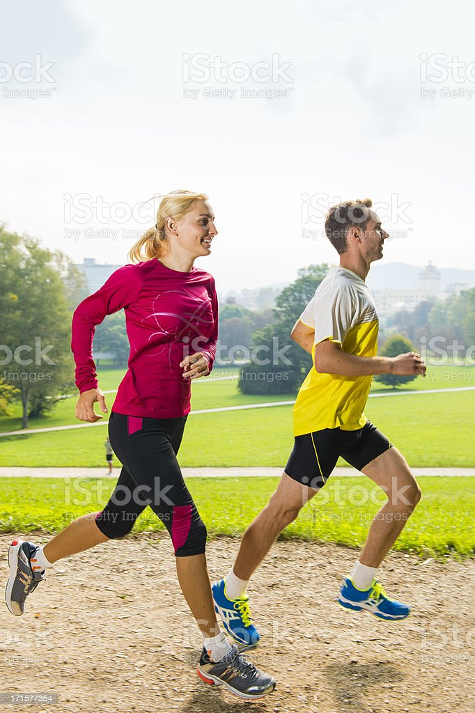 Young couple jogging in the park stock photo