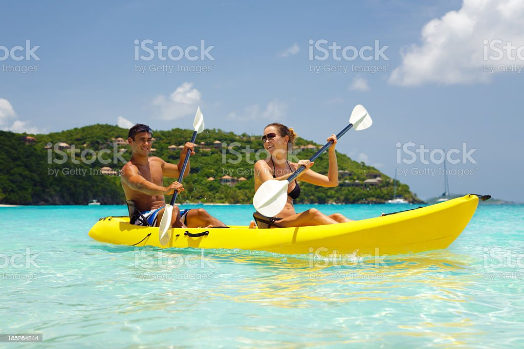 young couple kayaking in the Caribbean royalty-free stock photo
