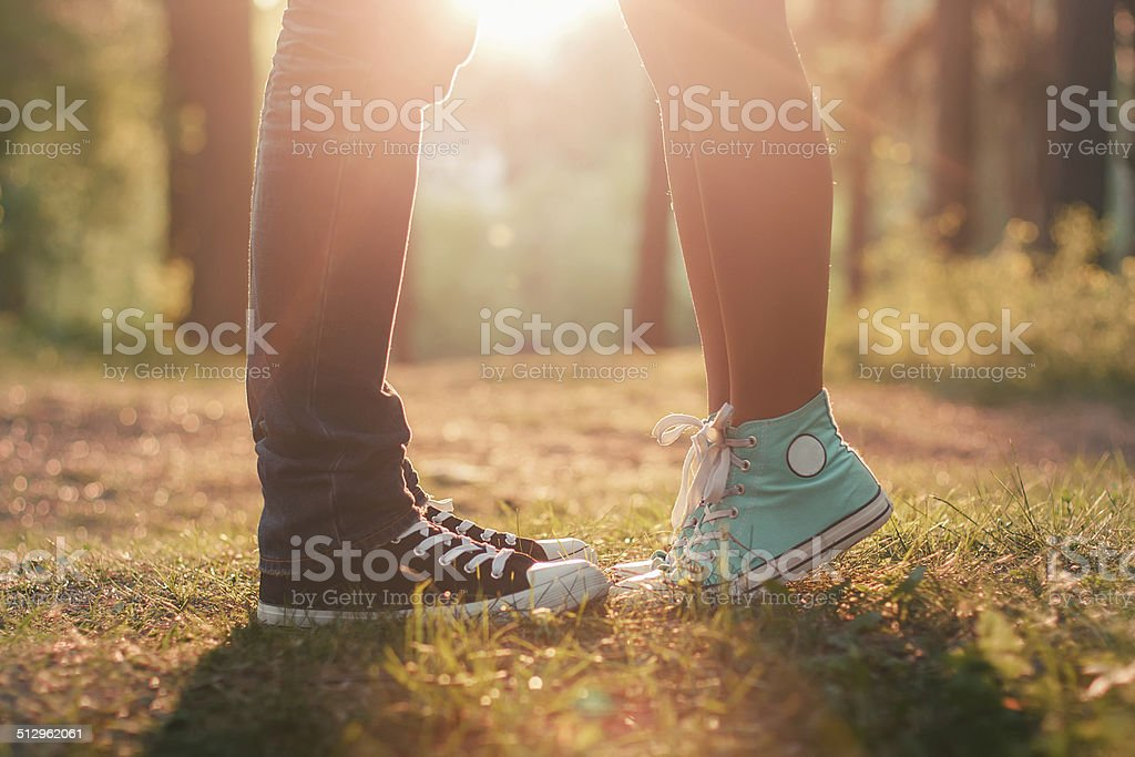 Young couple kissing in summer sun light stock photo