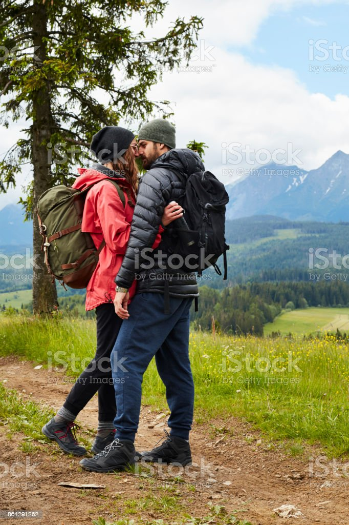 Young couple kissing in the mountains royalty-free stock photo
