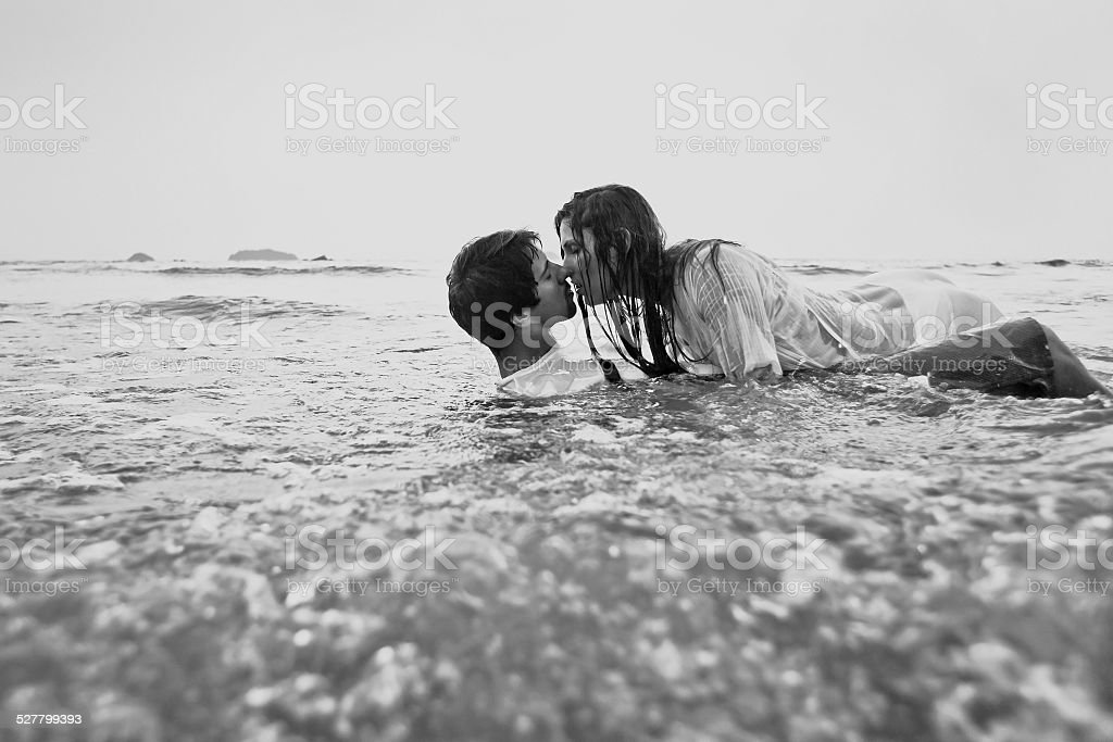 Young couple kissing in the water black and white royalty free stock photo