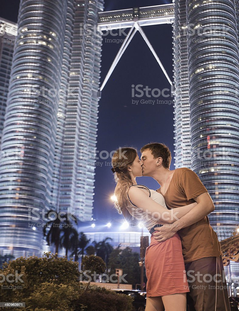 Young couple kissing on background of two petronas twin towers stock young couple kissing on background of two petronas twin towers royalty free stock photo buycottarizona Gallery