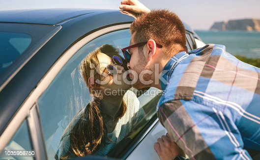 istock Young couple kissing through the glass 1035956750