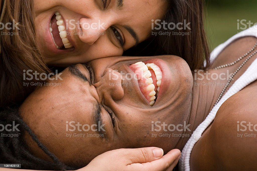 Young Couple Laughing and Cuddling Together royalty-free stock photo